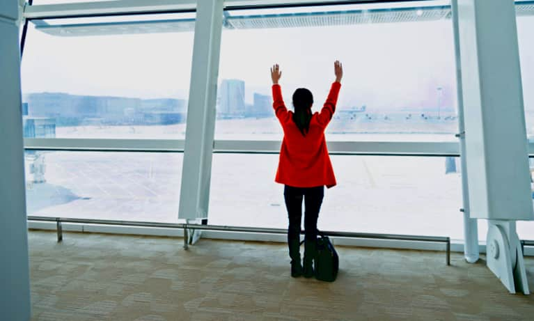 4 Yoga Stretches To Do On Your Next Flight