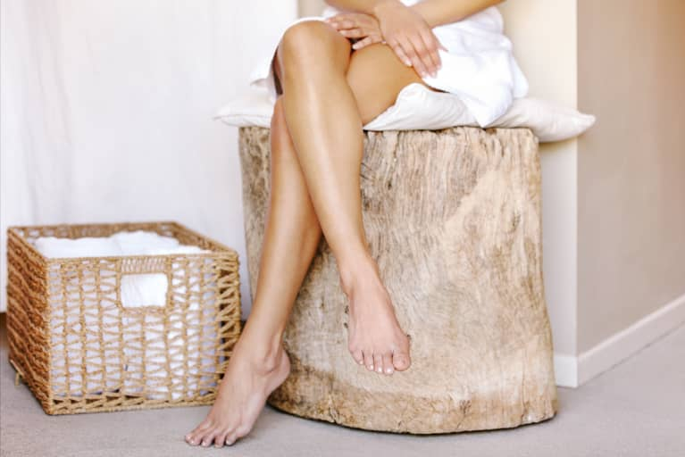 Woman Sitting in a Towel at a Spa