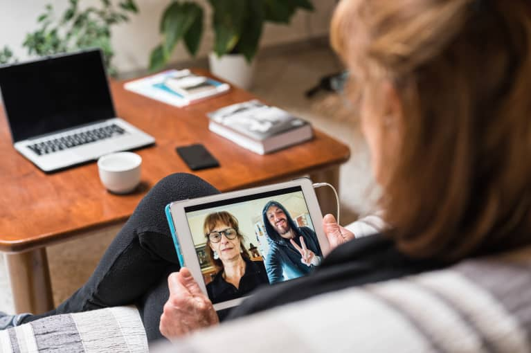 Woman Having A Video Call With Distant Family Using A Digital Tablet