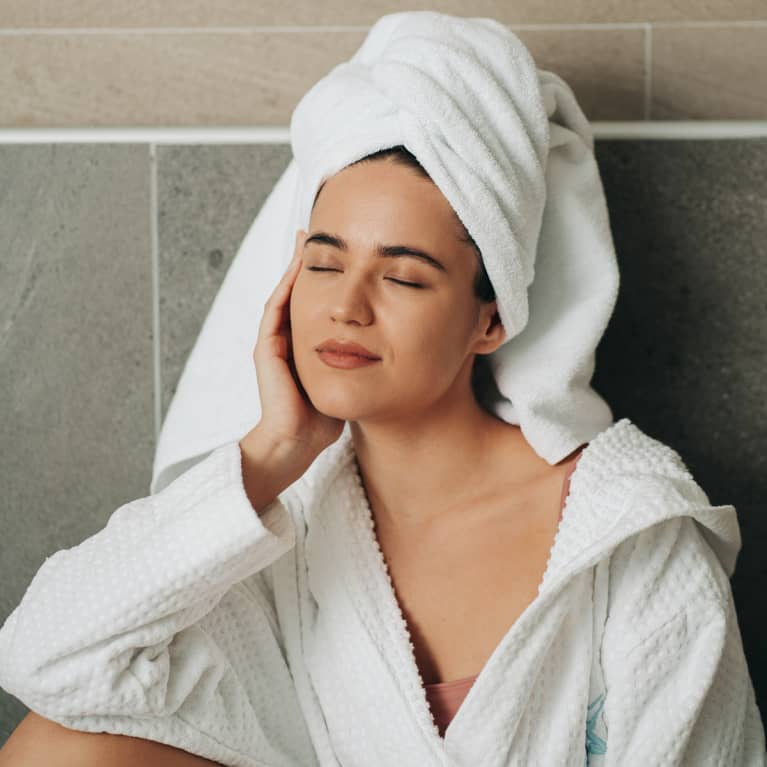 Woman In A Bathrobe and Towel Enjoying a Relaxing Moment