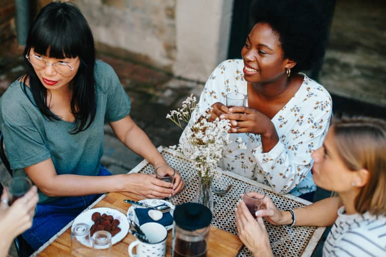 Group of Women Drinking Coffee Outdoors at a Cafe
