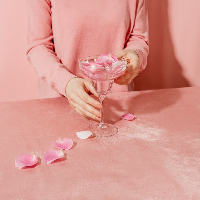 Woman in Pink With a Glass of Rose Water
