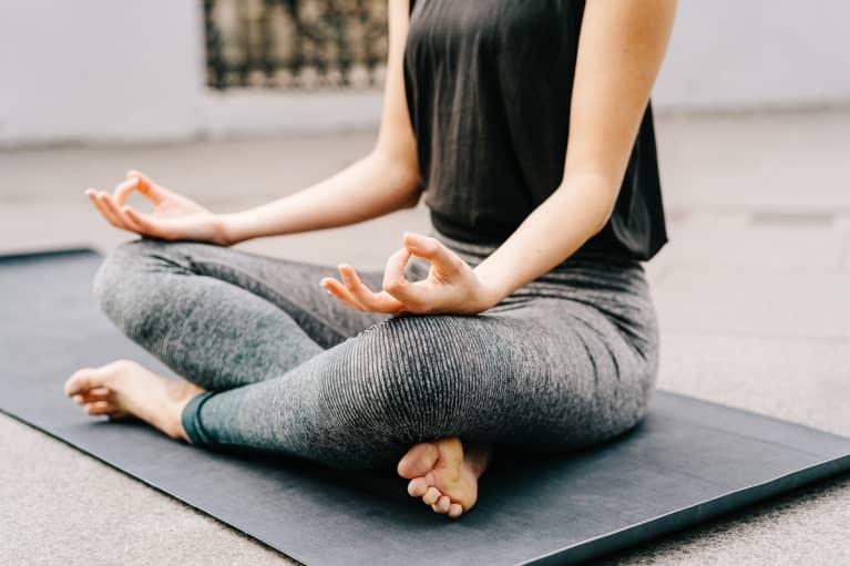Woman Doing Yoga Outdoors At The City, Jnana Mudra