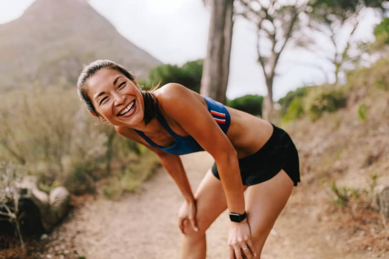 Woman Running Outdoors, Catching Her Breath