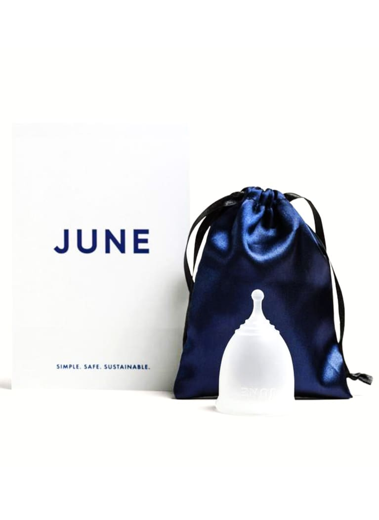 Clear menstrual cup with June packaging and blue silk bag