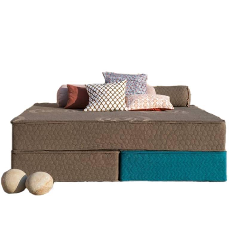 brown mattress with pillows