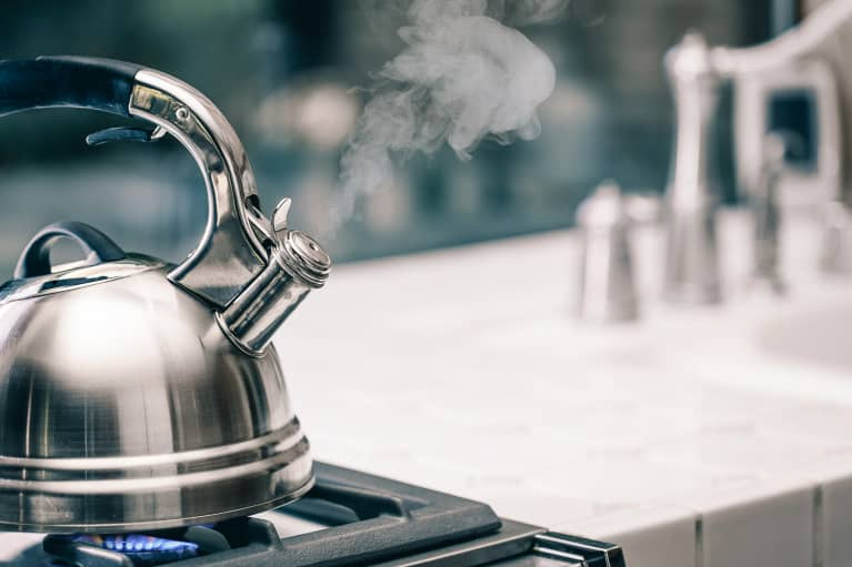 Tea Kettle Boiling on a Kitchen Stove