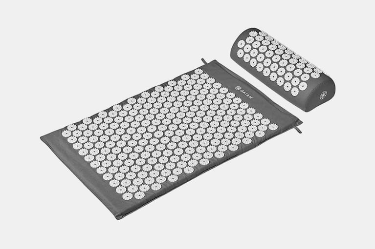 grey acupressure mat and pillow