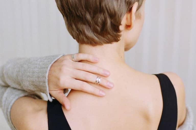Woman Rubbing Back of Neck