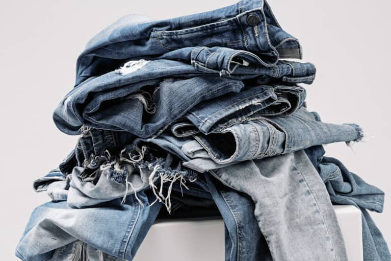 stack of donated jeans