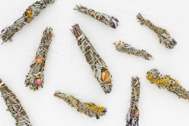 Handmade floral wild sage smudge sticks on white linen
