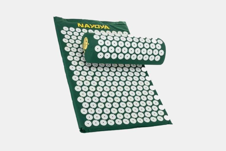 green acupressure mat and pillow