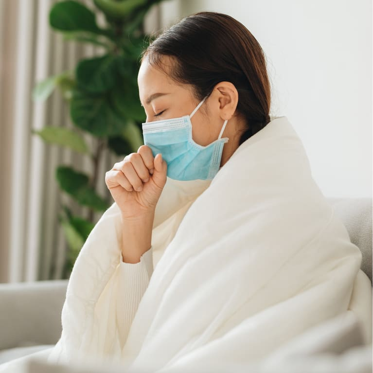 Respiratory Droplets Can Still Spread When You Cough Wearing A Mask, New Study Finds