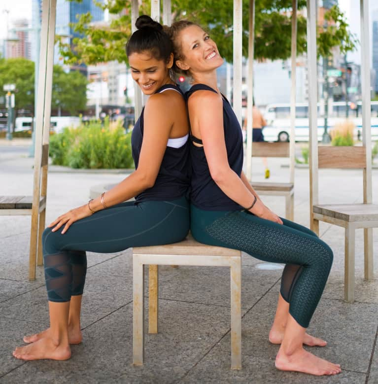 Why The Benefits Of Yoga Double When You Do It With A Friend