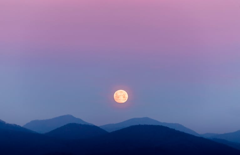 moon over mountains and night sky