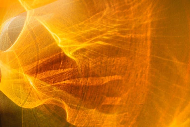 Orange Abstract Light Shining Through Acetate