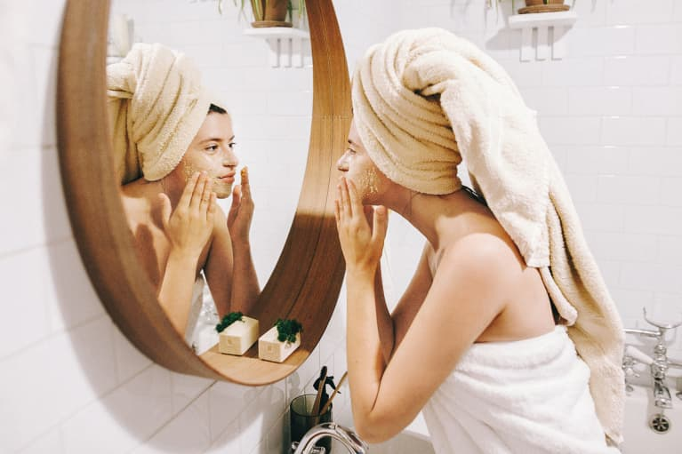 Young Woman Using a Facial Scrub
