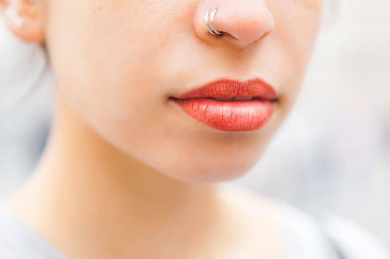 woman with a red lip and nose ring