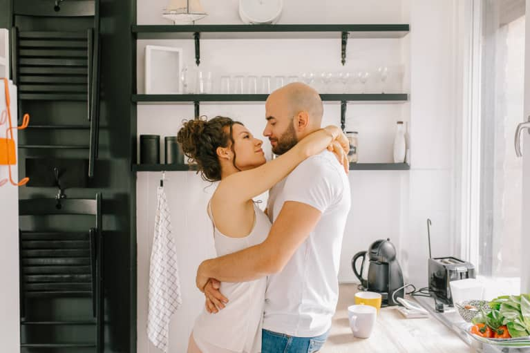 Young couple embracing in the kitchen