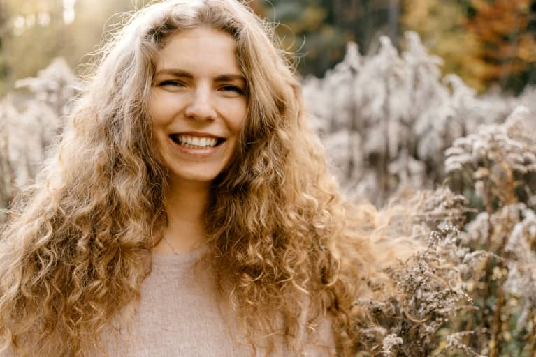 Portrait Of Beautiful Young Woman With Blonde Curly Hair