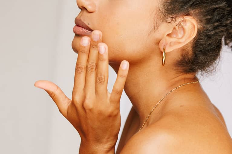 Woman With Bare Nails Touching Her Face