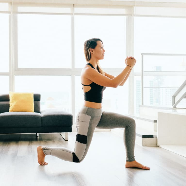 Woman Doing Lunges in Her Living Room