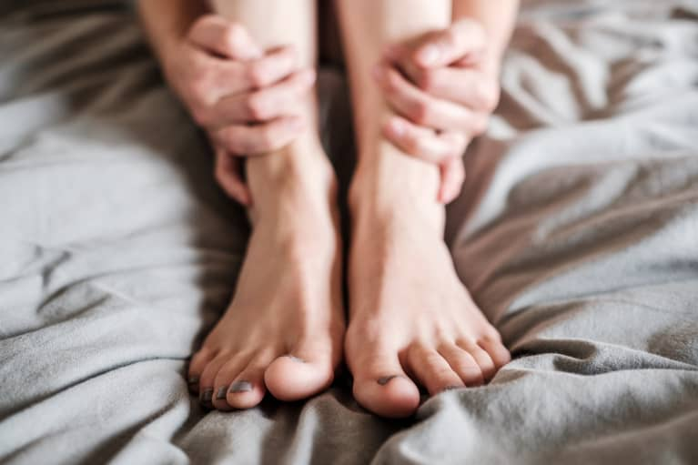 Always Have Cold Hands & Feet? Here's What It Could Mean, From An MD