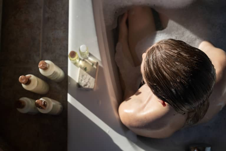 woman in bath with oil on hair