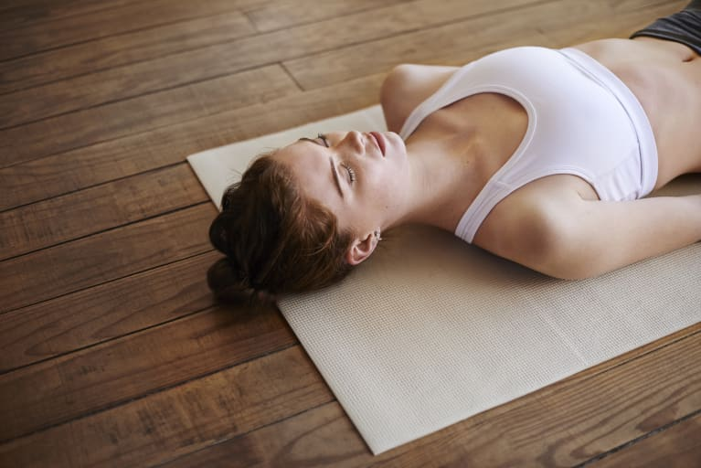 Woman Practicing Mindfulness and Meditating on a Yoga Mat