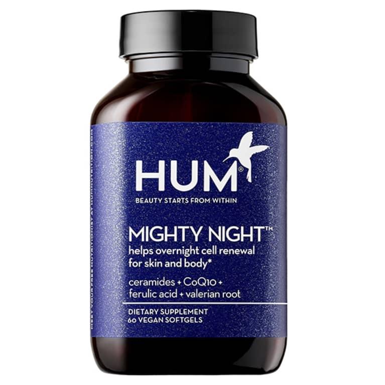 black supplement bottle with dark blue label