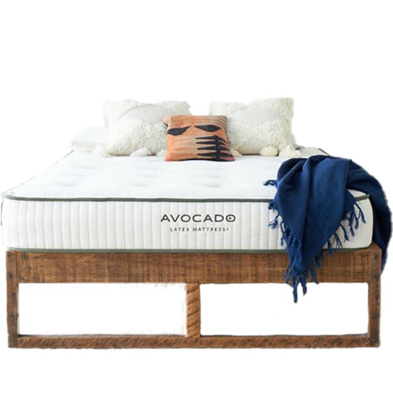 white mattress on brown bed frame