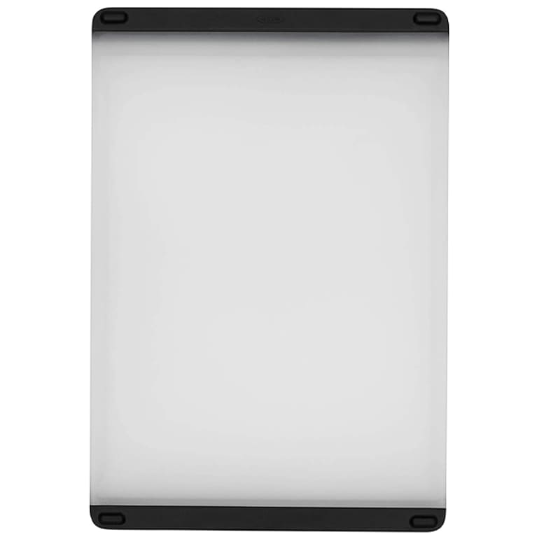white plastic cutting board with black silicone grips