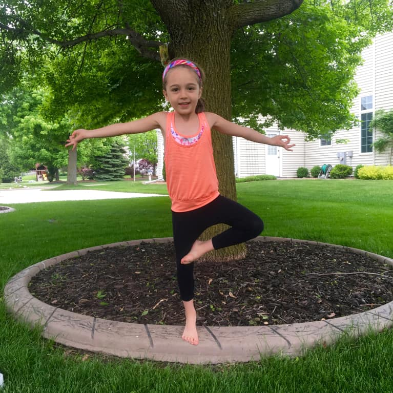 A 5-Minute Energizing Yoga Sequence You Can Do With Your Kid
