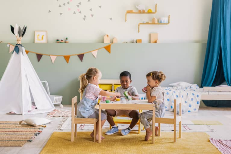 Three Children Having a Tea Party in a Child's Bedroom