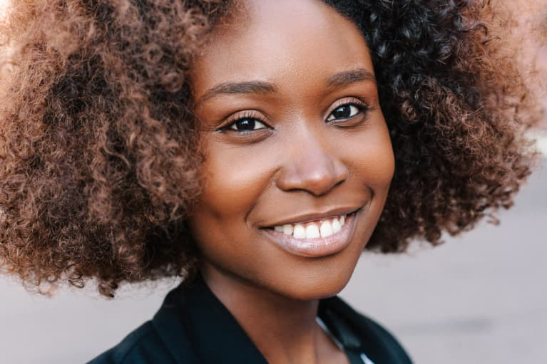 Close Up Portrait Of a Woman With Natural Hair and a Beautiful Smile