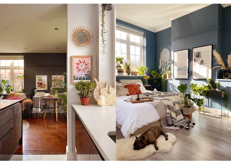 blue bedroom with deep blue walls and wood floors