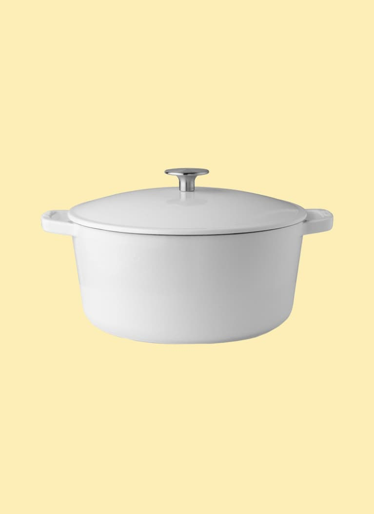 Milo brand small dutch oven in white on yellow background
