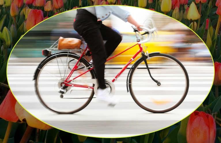 person biking through busy street