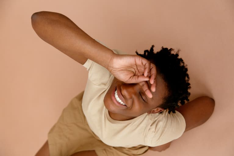 Young black woman touching her forehead