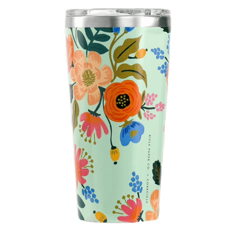 green coffee tumbler with bright flower design