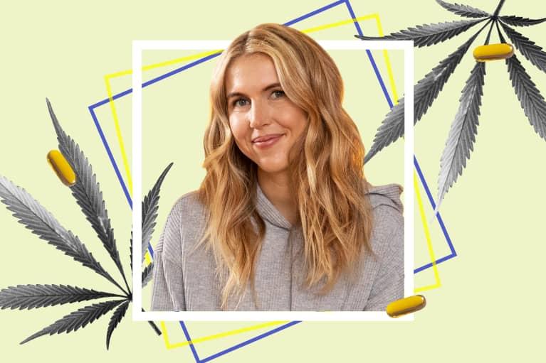 Amanda Quadrini taking a mindbodygreen hemp multi+ pill at home