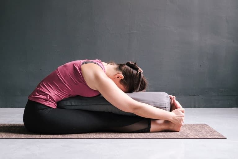 Supported Paschimottanasana for Digestion