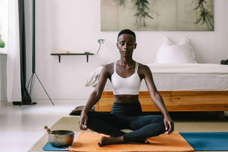 Young Woman Meditating at Home in the Morning
