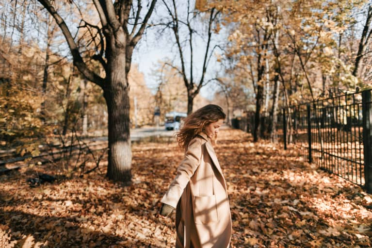 Woman Dancing in Autumn Leaves