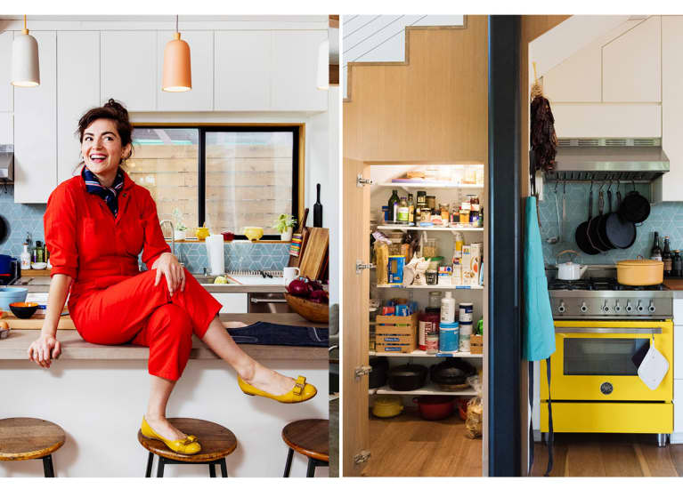 woman in red jumpsuit sitting in her colorful kitchen