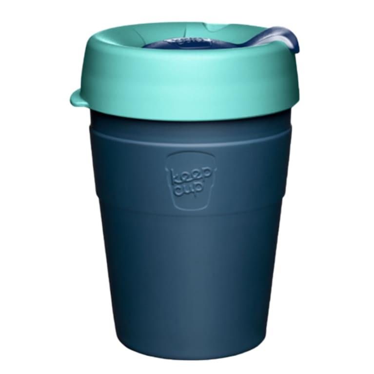 dark blue coffee cup with teal lid