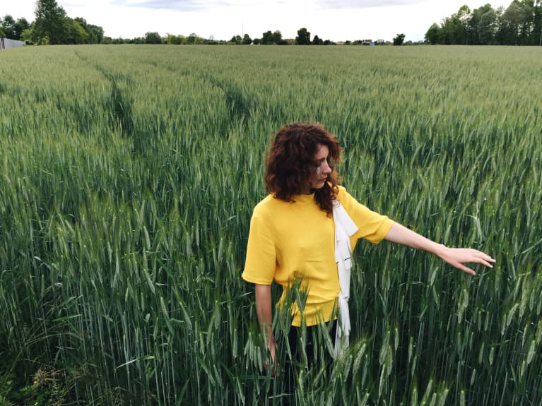 Lonely single woman in a field of tall grass