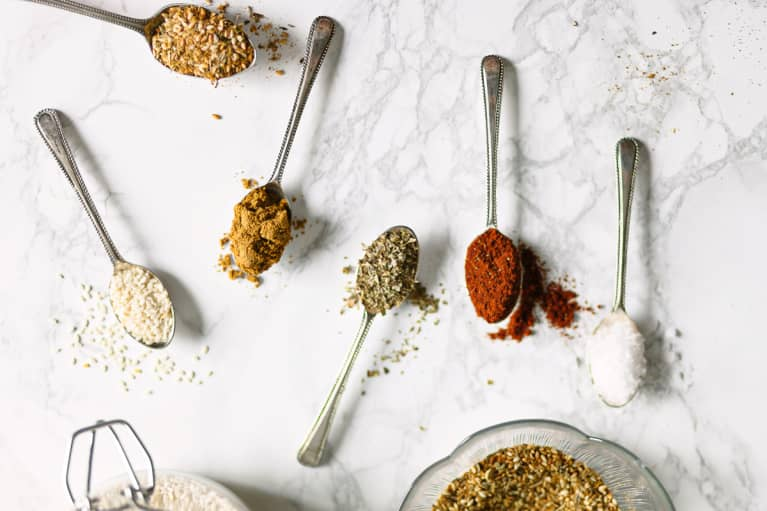 Herbs And Spices On Spoons On A Marble Background.