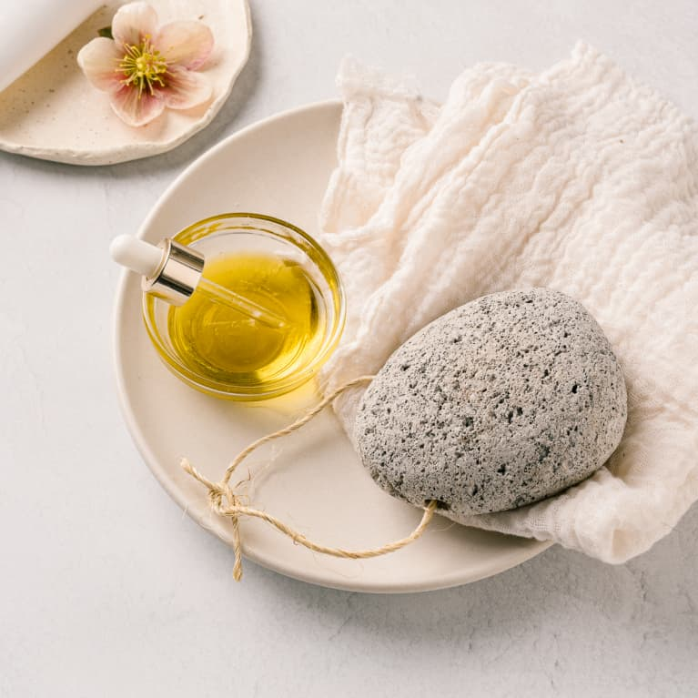 Still life of oils, lotion, bath salt and a pumice stone for skin care regimen