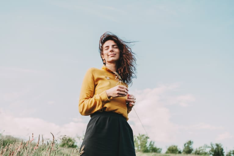 Smiling Relaxed Woman in a Field